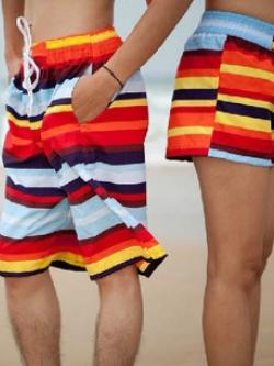 พร้อมส่ง กางเกงขาสั้นคู่รัก ผ้าฝ้ายสกรีนลายทาง เอวยางยืด โทนสีส้มแดง