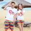 เสื้อคู่รัก ชุดคู่รักเที่ยวทะเลชาย +หญิง เสื้อยืดสีขาวลาย LO VE กางเกงขาสั้นลายแถบสีโทนสีรุ้ง +พร้อมส่ง+ thumbnail 1