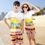 เสื้อคู่รัก ชุดคู่รักเที่ยวทะเลชาย +หญิง เสื้อยืดสีขาวลายคู่รักขับรถเที่ยวชายหาด กางเกงขาสั้นลายแถบสี +พร้อมส่ง+ thumbnail 1