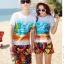 เสื้อคู่รัก ชุดคู่รักเที่ยวทะเลชาย +หญิง เสื้อยืดสีขาวลายคู่รักนอนตากแดด กางเกงขาสั้นลายพระอาทิตย์โทนสีส้ม +พร้อมส่ง+ thumbnail 2