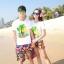เสื้อคู่รัก ชุดคู่รักเที่ยวทะเลชาย +หญิง เสื้อยืดสีขาวลายต้นมะพร้าว กางเกงขาสั้นลายพระอาทิตย์โทนสีส้ม +พร้อมส่ง+ thumbnail 1