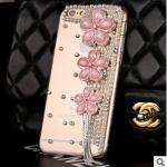 เคสไอโฟน 6 Plus กรอบใส ประดับมุกและพู่ห้อยดอกไม้ชมพู