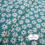 ผ้าคอตตอน 100% 1/4 ม.(50x55ซม.) พื้นสีเขียวลายดอกไม้สีขาว