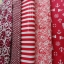 Set 5 ชิ้น : ผ้าคอตตอน 100% โทนสีแดง 5 ลาย ชิ้นละ1/8 ม.(50x27.5ซม.) thumbnail 1
