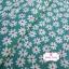 ผ้าคอตตอน 100% 1/4 ม.(50x55ซม.) พื้นสีเขียวลายดอกไม้สีขาว thumbnail 1