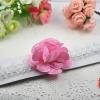 ผ้าคาดผมเด็กติดดอกไม้สีชมพู