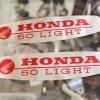 เพลทโลโก้ถังน้ำมัน Honda Light 50 C240 สภาพไม่เรียบเท่าไหร่ แท้-ใหม่