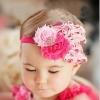 ผ้าคาดผมสาวน้อยแต่งขนนกชมพู ประดับดอกไม้ น่ารักมากๆ
