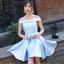 ชุดราตรีสั้น ตัวชุดเป็นผ้าไหมสีฟ้า ดีไซน์เปิดไหล่ ปิดต้นแขน thumbnail 1